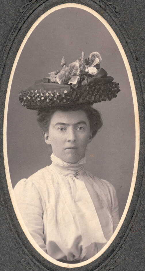 Photograph of young woman in large hat